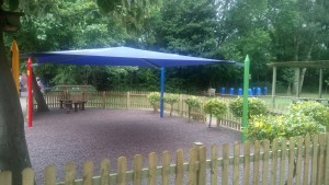 Resin Bonded Rubber Bark and Maxim Shade Canopy System
