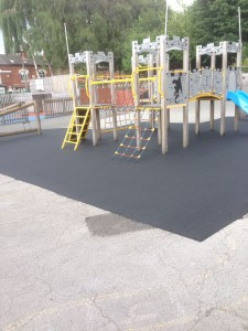 Black Wet Pour onto playground